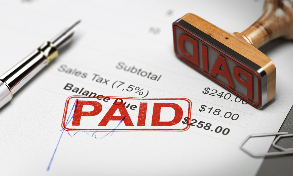 """An invoice that has been stamped """"Paid"""""""